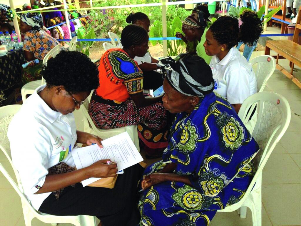 Women in the Iringa region of Tanzania attending a mass screening day for HIV and cervical and breast cancer, November 2015. The organisers, Pink Ribbon, Red Ribbon, make a point of acknowledging that the initiative, which screened 1,500 women over two days, and treated or referred on women who tested positive, relied on having a functioning local health system already in place (see http://tinyurl.com/Screening-Tanzania).